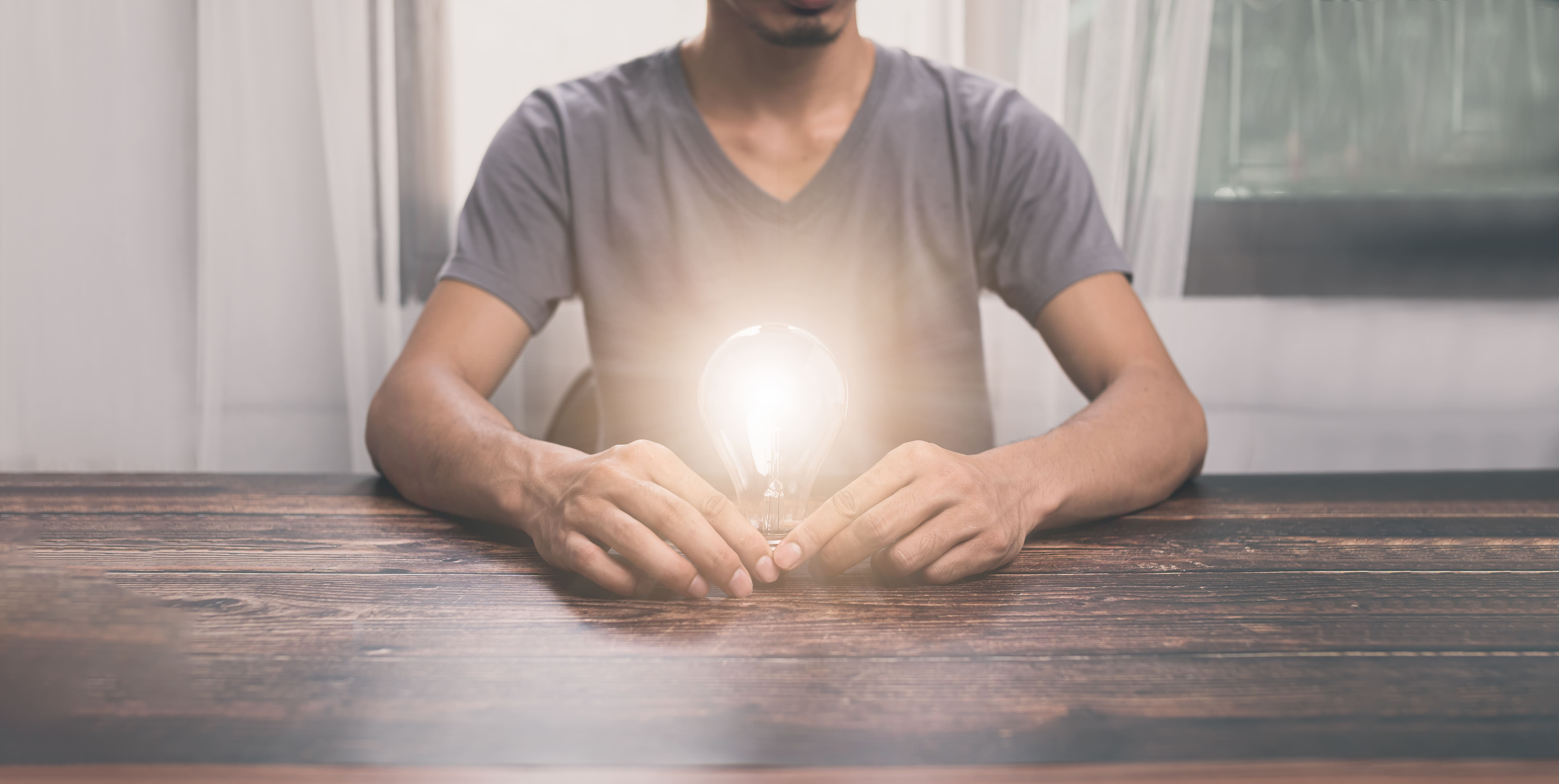 Man holding a light bulb, searching for ideas, new ideas, illust
